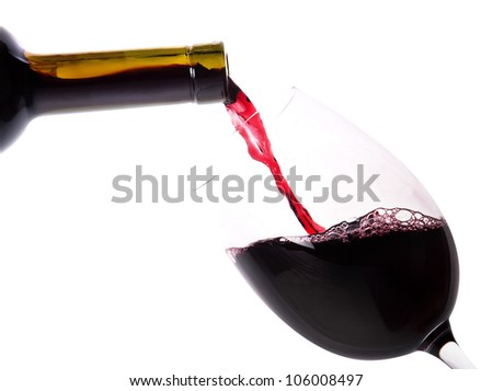 Red wine splashing on a white background - stock photo