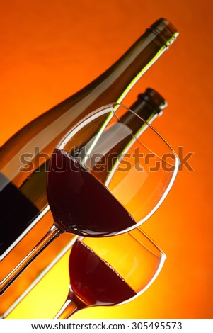 Red wine - still-life with glasses and bottles. Tilted composition. - stock photo