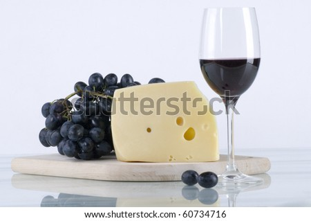 Red wine with cheese and grapes - stock photo