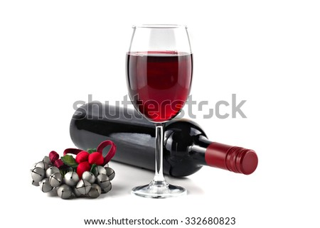 Red wine with Christmas ornament isolated on white background, shallow focus - stock photo