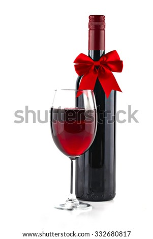 Red wine with Christmas ribbon isolated on white background, shallow focus - stock photo