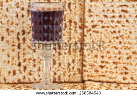 Red wine with Passover matza  - stock photo