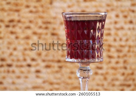 Red wine with Passover matza background  - stock photo