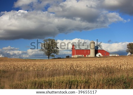 red wisconsin barn with clouds - stock photo