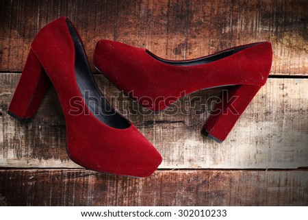 Red woman shoes isolated on old wood  - stock photo