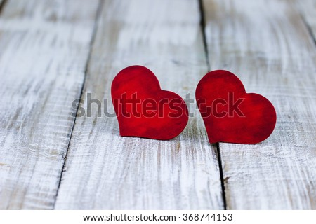 Red wood hearts on white painted rustic antique wooden background; Valentine's Day and love concept - stock photo