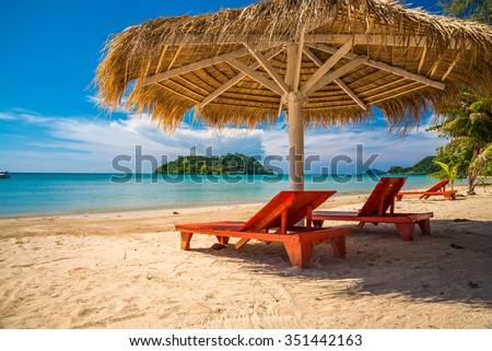Red wooden daybed on beautiful tropical island beach Koh Mak, Trat Thailand - Selective focus - stock photo