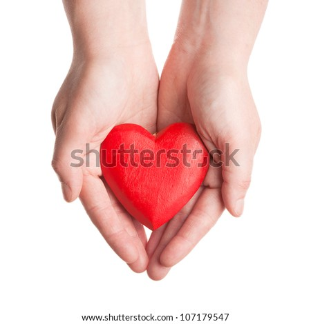 Red wooden heart in woman's hands isolated on white - stock photo