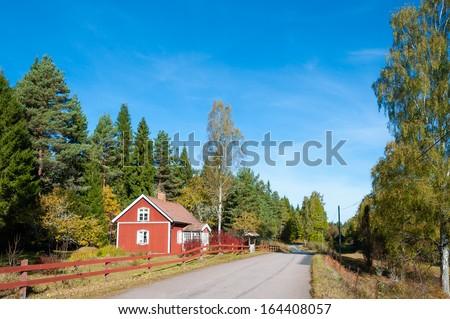 Red wooden house in the woods of Smal���¶and, Sweden - stock photo