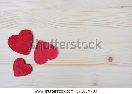 Red wooden Valentine Day hearts - stock photo