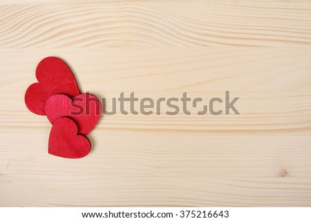 Red wooden Valentine Day hearts on board - stock photo