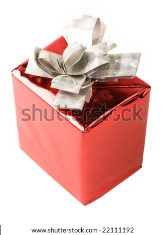 Red wrapped gift with silver knot on top isolated over white background - stock photo