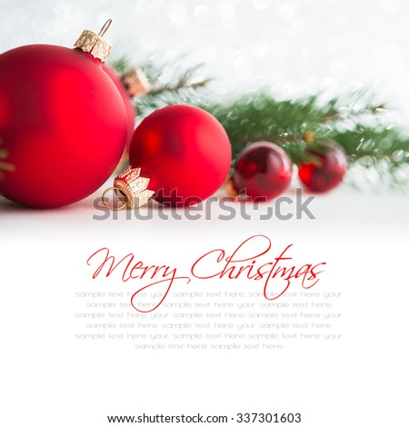 Red xmas ornaments and xmas tree on white background. Merry christmas card. Winter holidays. Xmas theme. Happy New Year. Space for text. - stock photo