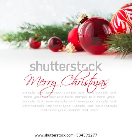 Red xmas ornaments on white background. Merry christmas card. Winter holiday theme. Happy New Year. Space for text. - stock photo