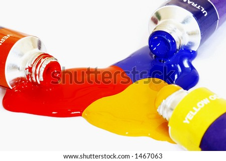 Red yellow and blue acrylic paints pouring from a tube. Colour can be easily changed to any colour using hue/saturation in photo package - stock photo