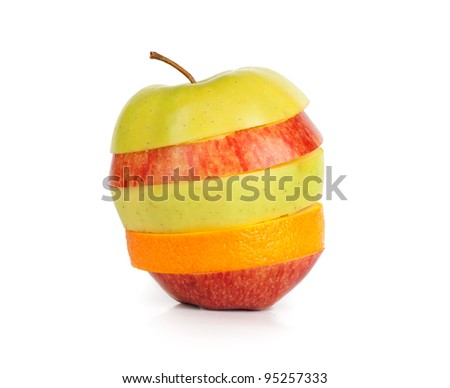 Red, yellow and green sliced apple - stock photo