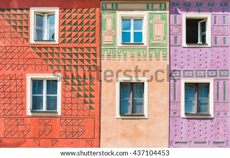 Red, yellow and purple houses on the main square of Polish town Poznan closeup - stock photo