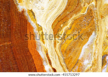 red yellow stone texture background, select focus with shallow depth of field: ideal use for background. - stock photo