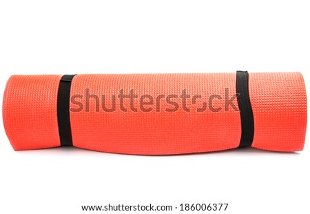 Red yoga mat nice for exercise at home or gym - stock photo