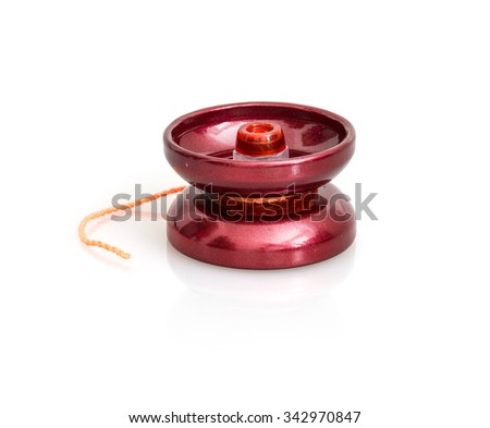 Red yoyo with twine on the white background. Toy theme. - stock photo