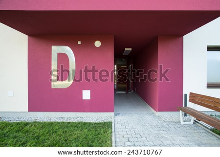 Reddish staircase in new exclusive block of flats - stock photo