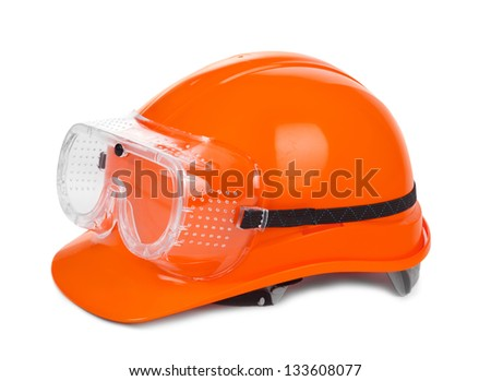 redhard hat and goggles on white, small natural shadow under object - stock photo