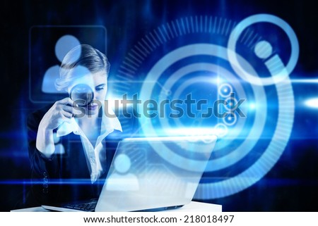 Redhead businesswoman using her laptop against blue technology design with profiles - stock photo
