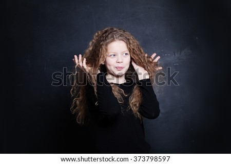Redhead Child Girl. Cute Child with Long Red Hair - stock photo
