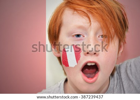 redhead fan boy with peruvian flag painted on his face.  - stock photo
