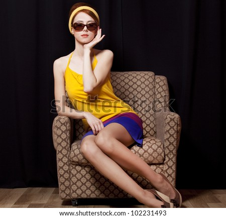 Redhead girl in armchair. 70s - stock photo