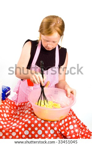 redhead girl is making pancake dough isolated on white - stock photo
