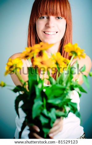 redhead girl with yellow flowers - stock photo