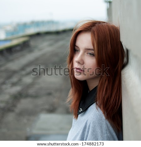 Redhead hipster girl on the roof - stock photo