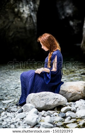 Redhead lady, waiting for her lord with blue medieval dress - stock photo