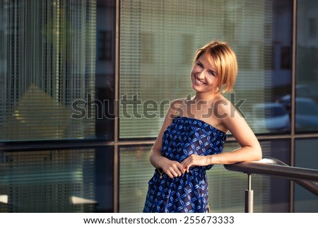 Redhead outdoors backlit by sun - stock photo