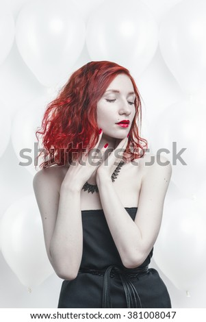 redhead young woman portrait on white balloon background - stock photo