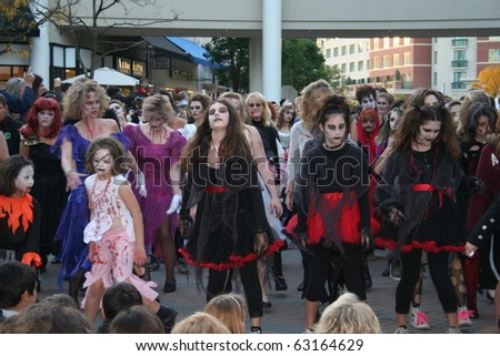 """REDMOND, WASHINGTON USA - OCT 25: unidentified Dancers dressed as zombies perform Oct 25 2009 in Redmond, Washington. Annually, dancers around the world perform a """"Thrill the World"""" zombie dance. - stock photo"""