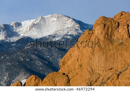 Redrock formations and Pikes Peak in the background - stock photo