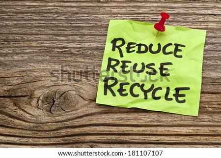 reduce, reuse and recycle reminder note against grained wood - resource conservation concept - stock photo