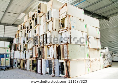 reduce, reuse, recycle of refrigerators in a recycling plant. - stock photo