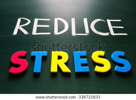 Reduce stress concept, colorful words on blackboard - stock photo