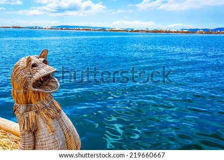 Reed boat at Uros floating islands on Lake Titicaca near Puno, Peru - stock photo