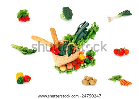 Reed shopping bag with fresh shopping surrounded with vegetables on reflective surface, studio shot, white background. - stock photo