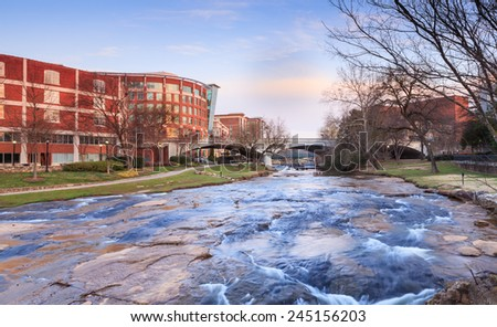 Reedy River flowing through the center of downtown Greenville, South Carolina. - stock photo