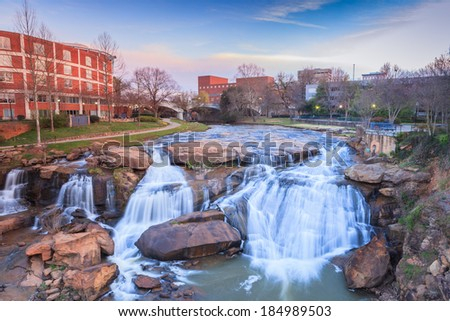 Reedy River Waterfalls run through the middle of downtown Greenville, South Carolina at Falls Park River Walk. - stock photo