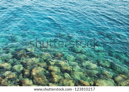 Reefs in transparent azure water - stock photo