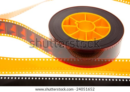 Reel and film leader isolated in white background - stock photo