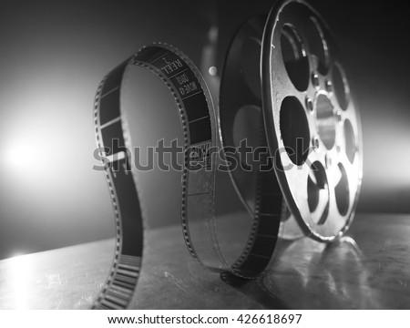 Reel of film on a black-white background  - stock photo