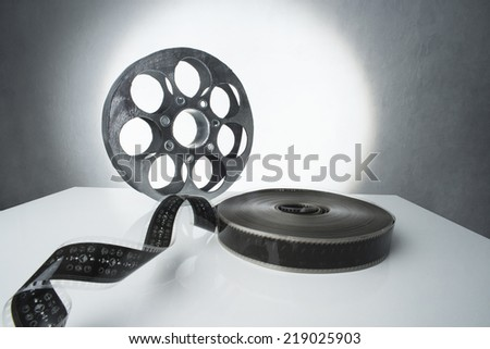 Reel of film on a white background - stock photo