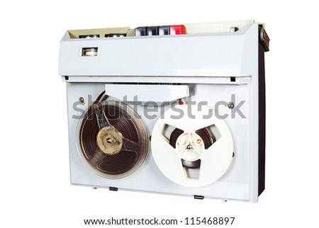 reel tape recorder on table, wall with newspaper, wallpapers - stock photo